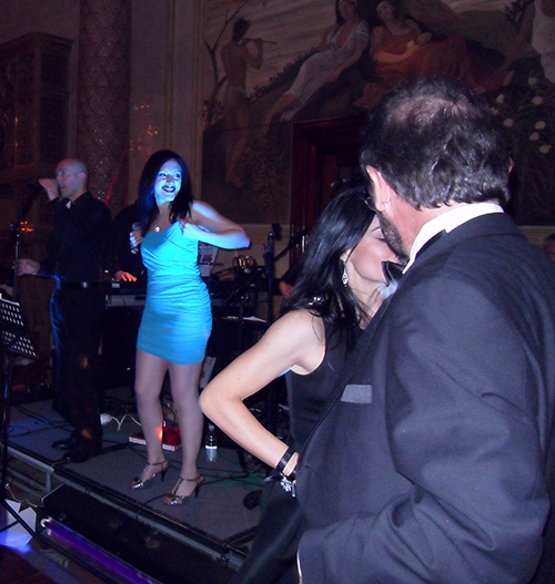 Firefly, the party band for hire, singing with couples dancing